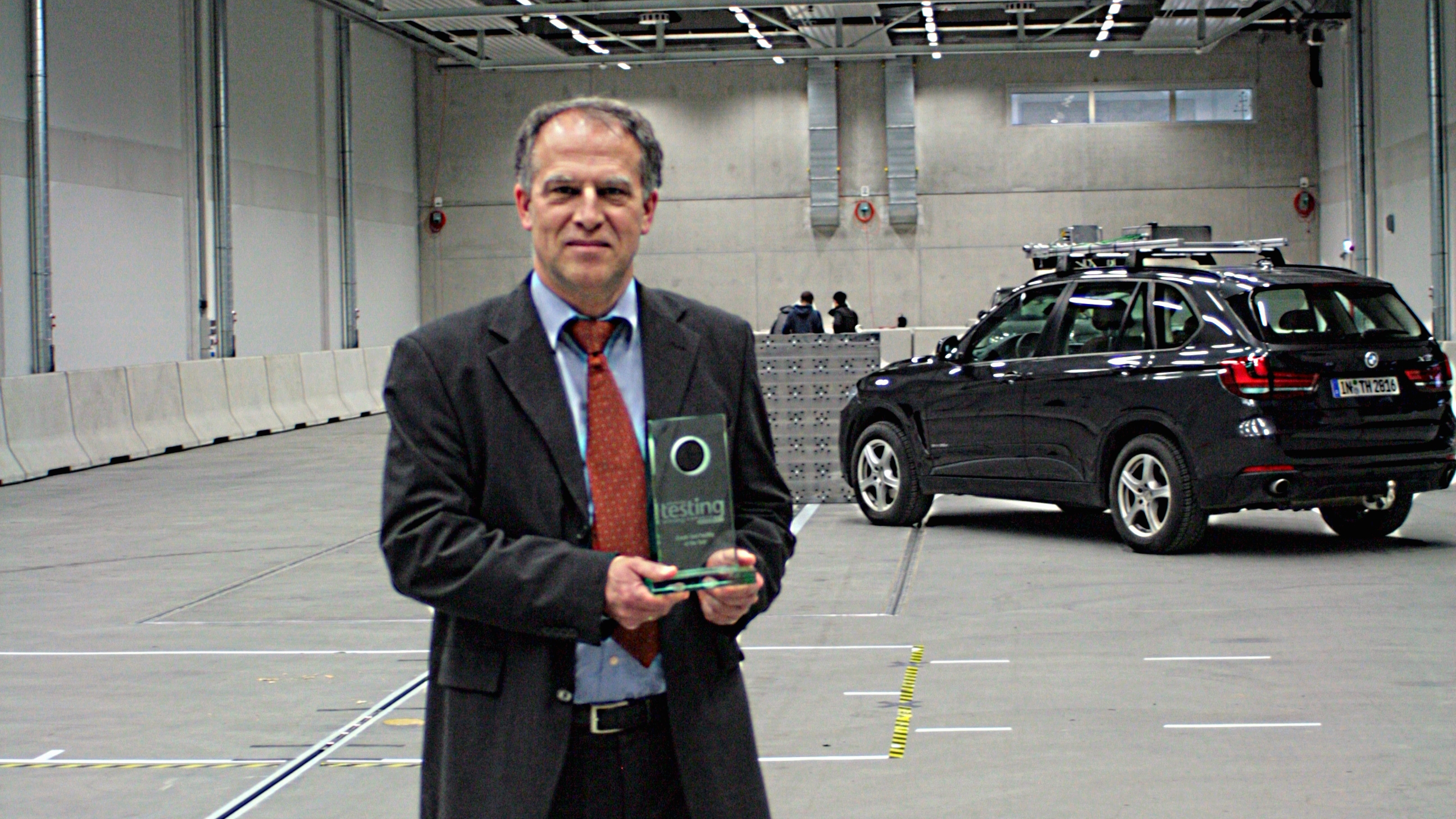 Prof Brandmeier, head of the test centre, in the hall for road tests with prize