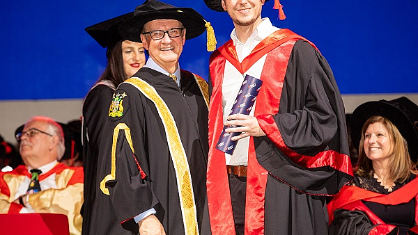 Presentation of the doctoral certificate to Dr. Michael Roth at RMIT in Melbourne