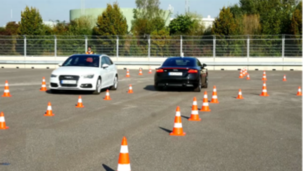 Two vehicles drive on the test track
